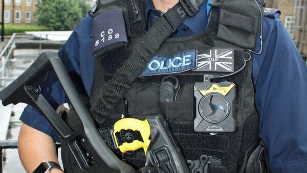 Armed police officer with body worn video - Sputnik International
