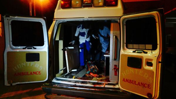 An injured victim of a female suicide bomber arrives in an ambulance for medical attention at a Maiduguri hospital in northeast Nigeria on August 15, 2017 - Sputnik International