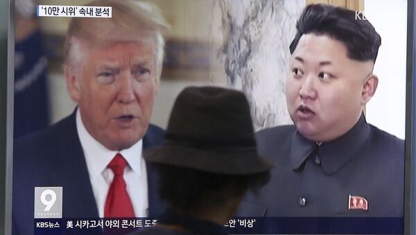 In this Aug. 10, 2017, file photo, a man watches a television screen showing U.S. President Donald Trump and North Korean leader Kim Jong-un during a news program at the Seoul Train Station in Seoul, South Korea. - Sputnik International