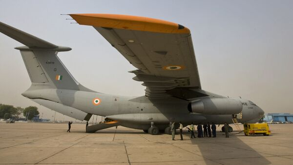 Indian Air Force personnel stand near an IL 76 aircraft as they prepare for departure with relief materials, including tents, blankets and medicines, for cyclone-affected Myanmar, at the airport in New Delhi, India, Thursday, May 8, 2008 - Sputnik International