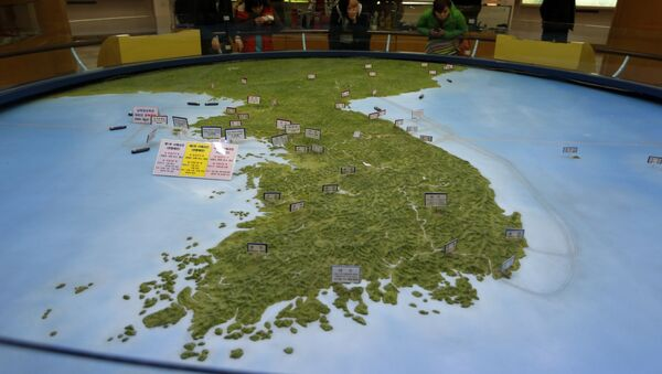 In this Feb. 10, 2016, file photo, visitors look at a map of the Korean peninsula at the exhibition hall of the unification observatory in Paju, South Korea - Sputnik International