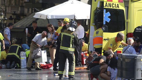 Injured people are treated in Barcelona, Spain, Thursday, Aug. 17, 2017 after a white van jumped the sidewalk in the historic Las Ramblas district, crashing into a summer crowd of residents and tourists and injuring several people, police said. - Sputnik International