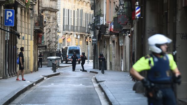 Police secure the area close to the scene after a white van jumped the sidewalk in the historic Las Ramblas district of Barcelona, Spain, crashing into a summer crowd of residents and tourists Thursday, Aug. 17, 2017. - Sputnik International