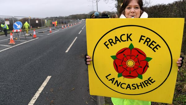 (File) Protesters hold placards at the Preston New Road site where Energy firm Cuadrilla are setting up fracking (hydraulic fracturing) operations at Little Plumpton near Blackpool in northwest England on January 10, 2017 - Sputnik International