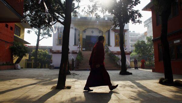 A Tibetan monk walks inside a deserted Tibetan Monastery at Boudhanath Stupa in Katmandu, Nepal. (File) - Sputnik International