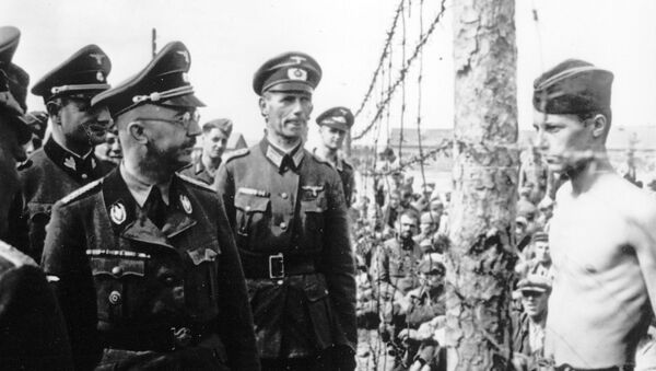 This undated photograph shows the Head of the Nazi German SS and Gestapo, Heinrich Himmler, as he inspects a German prisoner of war camp at an unknown location in the Soviet Union. - Sputnik International