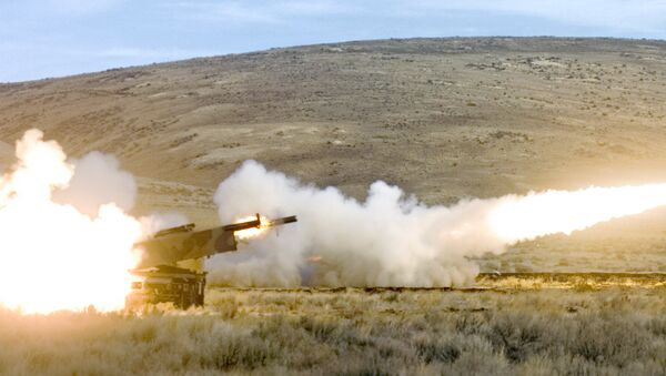 Members of the 17th Fires Brigade from Ft. Lewis fire two High Mobility Artillery Rocket System (HIMARS) rockets simultaneously in a training exercise at Yakima Training Center Nov. 1, 2007 in Yakima, Wash. - Sputnik International