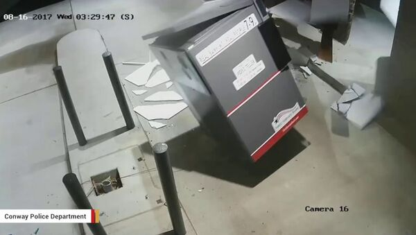 Screenshot of surveillance footage shows thieves using a forklift to steal an ATM in Arkansas. - Sputnik International