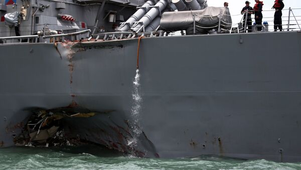 The U.S. Navy guided-missile destroyer USS John S. McCain is seen after a collision, in Singapore waters August 21, 2017. - Sputnik International