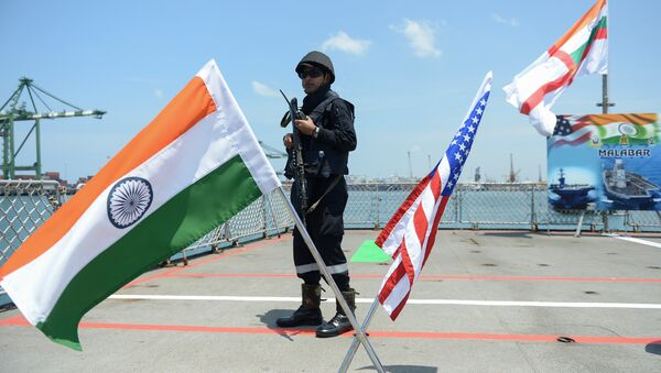An Indian Navy sailor stands guard on the deck of the INS Shivalik during the inauguration of joint naval exercises with the United States and Japan in Chennai on July 10, 2017 - Sputnik International
