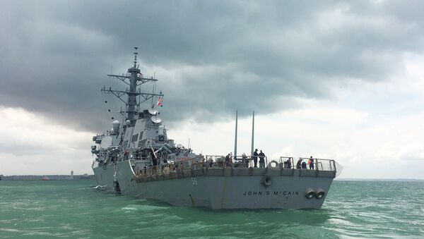 The U.S. Navy guided-missile destroyer USS John S. McCain is seen after a collision, in Singapore waters August 21, 2017 - Sputnik International