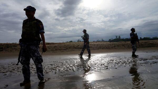 A Myanmar border guard police officers stand guard in Buthidaung, northern Rakhine state, Myanmar (File) - Sputnik International