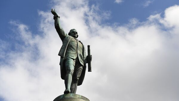 A statue of Captain James Cook stands in Sydney's Hyde Park on August 25, 2017, as Prime Minister Malcolm Turnbull labelled calls to change colonial-era monuments and the date of Australia Day, in attempts to better reflect the country's indigenous past, as a 'Stalinist' excercise in re-writing history. A cultural debate intensified this week when prominent indigenous commentator Stan Grant dubbed the inscription Discovered this territory 1770, on a Sydney statue of 18th century British explorer Capitan James Cook, a damaging myth. - Sputnik International