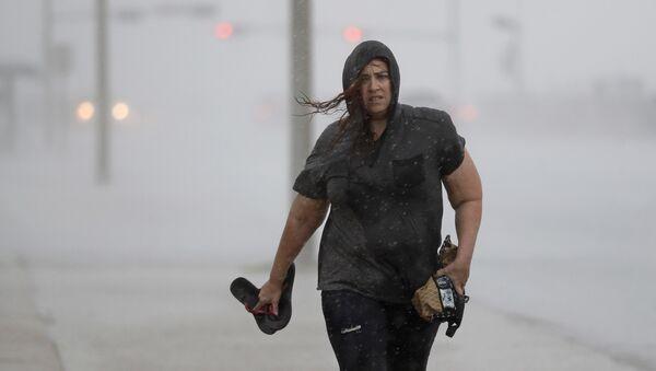 Hillary Lebeb walks along the seawall in Galveston, Texas as Hurricane Harvey intensifies in the Gulf of Mexico Friday, Aug. 25, 2017. - Sputnik International