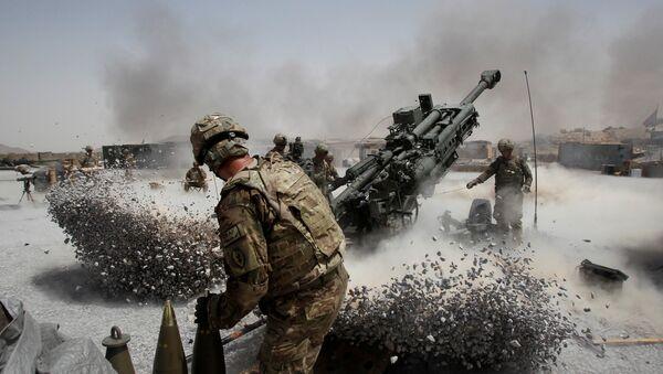 U.S. Army soldiers from the 2nd Platoon, B battery 2-8 field artillery, fire a howitzer artillery piece at Seprwan Ghar forward fire base in Panjwai district, Kandahar province southern Afghanistan (File) - Sputnik International