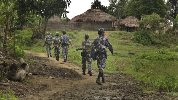 In this Friday, July 14, 2017 photo, Myanmar Border Guard Police (BGP) officers walk along a path ahead of journalists in Tin May village, in which Myanmar government and military claim the existence of Muslim terrorists in Buthidaung, Rakhine State, Myanmar. - Sputnik International