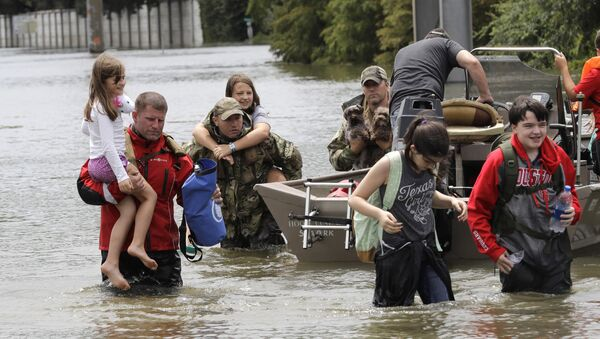 Residents are rescued from their homes surrounded by floodwaters from Tropical Storm Harvey on Sunday, Aug. 27, 2017, in Houston, Texas. - Sputnik International