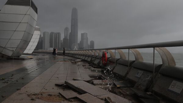 Debris caused by Typhoon Hato damage is strewn across the waterfront of Victoria Habour in Hong Kong, Wednesday, Aug. 23, 2017. - Sputnik International