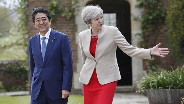 Britain's Prime Minister Theresa May shows Prime Minister Shinzo Abe of Japan around the garden at Chequers near Wendover, England, Friday, April 28, 2017. - Sputnik International