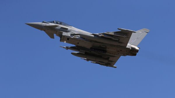 In this Thursday, Sept. 22, 2016, a Typhoon aircraft takes off from RAF, Akrotiri, Cyprus. British air forces for a mission in Iraq. British Tornado and Typhoon aircraft stationed at a U.K. air base in Cyprus are pounding Islamic State targets - Sputnik International