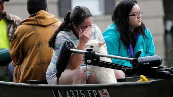 A woman is overcome with grief after being rescued from her home flooded by Tropical Storm Harvey in Orange, Texas, U.S., August 30, 2017. - Sputnik International