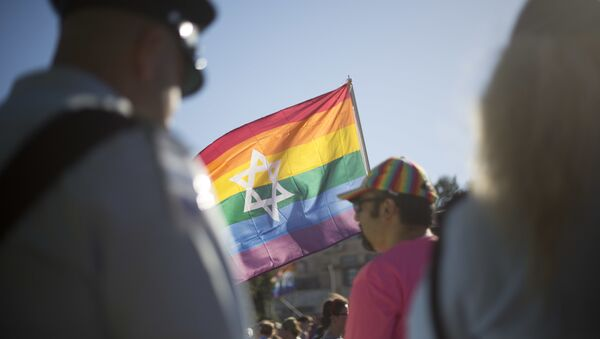 Israeli police officers watch as people take part in the annual gay pride parade in central Jerusalem, Thursday, July 21, 2016. - Sputnik International