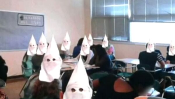 An altered photo showing Ku Klux Klan hoods digitally superimposed over students faces at a high school in Albuquerque, New Mexico. - Sputnik International