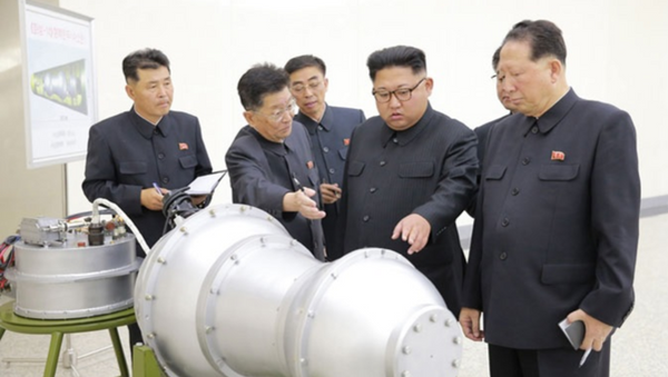 DPRK state-run media outlet KCNA September 3, 2017, handout purporting to show Pyongyang leader Kim Jong-un viewing newly developed miniaturized hydrogen bomb capable of being mounted on ICBM. // KCNA handout - Sputnik International