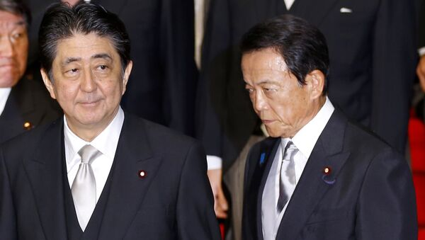 In this Aug. 3, 2017 photo, Japan's Prime Minister Shinzo Abe, left, and Deputy Prime Minister Taro Aso leave after an official photo session with Abe's new Cabinet at the prime minister's official residence in Tokyo - Sputnik International