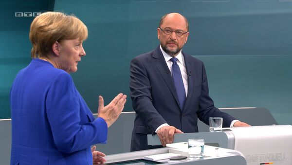 A screen that shows the TV debate between German Chancellor Angela Merkel of the Christian Democratic Union (CDU) and her challenger Germany's Social Democratic Party SPD candidate for chancellor Martin Schulz in Berlin, Germany, September 3, 2017. - Sputnik International