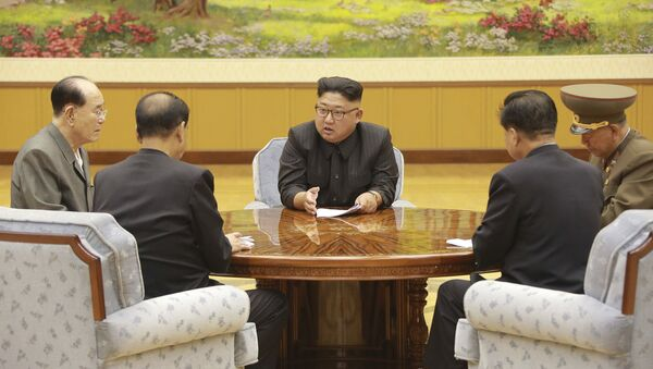 In this Sept. 3, 2017, image distributed on Monday, Sept. 4, 2017, by the North Korean government, North Korea's leader Kim Jong Un holds a meeting of the ruling party's presidium - Sputnik International