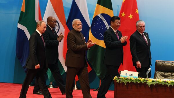 From left: Russian President Vladimir Putin, South African republic President jacob Zuma, Indian Prime Minister Narendra Modi, Chinese President Xi Jinping and Brazilian President Michel Temer seen at the BRICS leaders' meeting with BRICS Business Council members, September 4, 2017 - Sputnik International