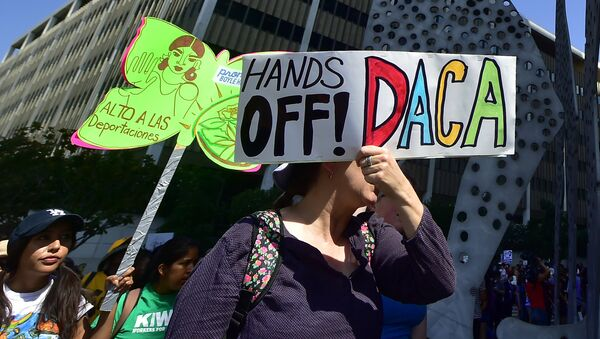 Young immigrants and supporters walk holding signs during a rally in support of Deferred Action for Childhood Arrivals (DACA) in Los Angeles, California - Sputnik International