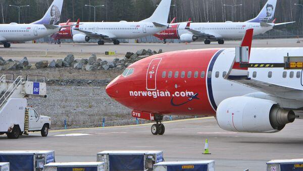 Parked Boeing 737-800 aircrafts belonging to budget carrier Norwegian seen at at Stockholm Arlanda Airport Thursday March 5, 2015 - Sputnik International