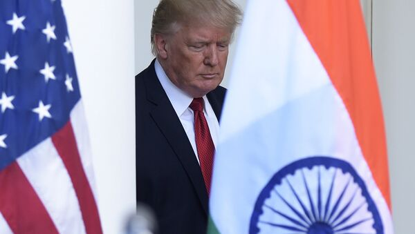 President Donald Trump walks out from the Oval Office to make a joint statement with Indian Prime Minister Narendra Modi in the Rose Garden of the White House in Washington - Sputnik International