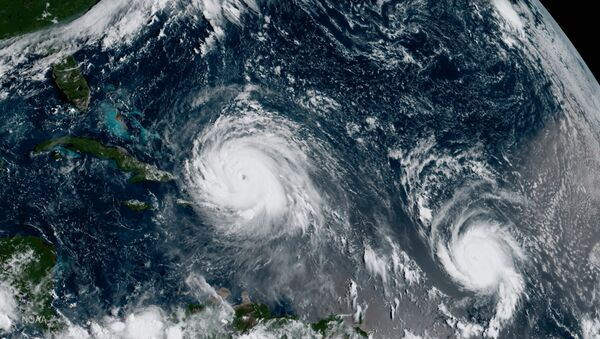 In this GOES-16 geocolor image satellite image taken Thursday, Sept. 7, 2017, the eye of Hurricane Irma, left, is just north of the island of Hispaniola, with Hurricane Jose, right, in the Atlantic Ocean - Sputnik International
