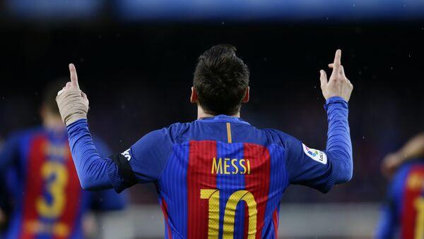 FC Barcelona's Lionel Messi celebrates after scoring during the Spanish La Liga soccer match between FC Barcelona and Sevilla at the Camp Nou stadium in Barcelona, Spain, Wednesday, April 5, 2017 - Sputnik International