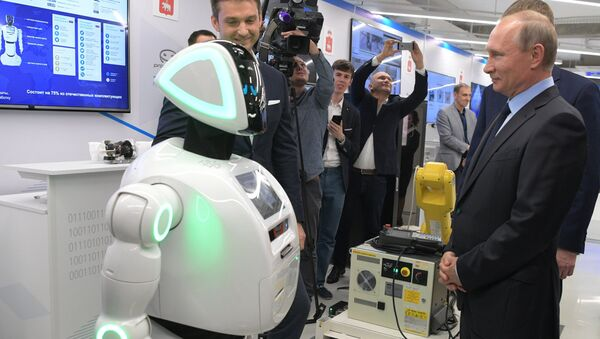 Russian President Vladimir Putin views a showroom of small and medium-size businesses engaged in 'digital economy' as he visits the ER-Telecom Holding in Perm - Sputnik International
