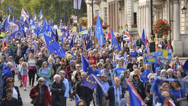 Demonstrators make their way along Piccadilly in London, Saturday Sept. 9, 2017, protesting Britain's plans to withdraw from the European Union - Sputnik International