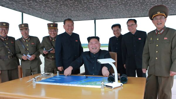 North Korean leader Kim Jong Un inspects a long and medium-range ballistic rocket launch drill in this undated photo released by North Korea's Korean Central News Agency (KCNA) in Pyongyang on August 30, 2017 - Sputnik International