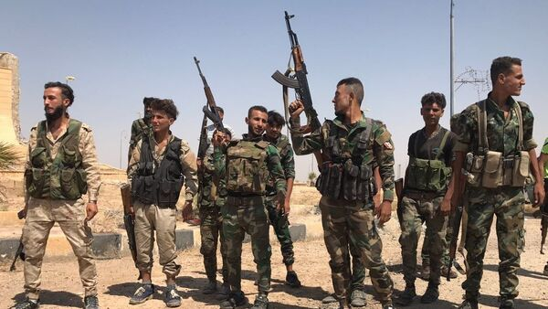 Troops of the Syrian 5th Army Corps join Syrian Army units in the south of Deir ez-Zor following the breaking of the ISIL blockade at the main entrance to the city in the south. File photo - Sputnik International