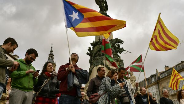 Pro independence supporters wave estelada or pro independence flags during a rally in support for the secession of the Catalonia region from Spain, in Vitoria, northern Spain, Saturday, Sept. 9, 2017 - Sputnik International