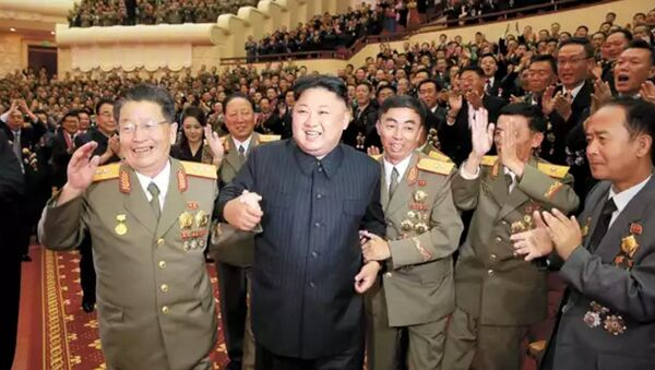 DPRK leader Kim Jong-un, flanked by the county's top nuclear-weapons officials, celebrates the country's weapons and ballistic missile achievements (KCNA image) - Sputnik International