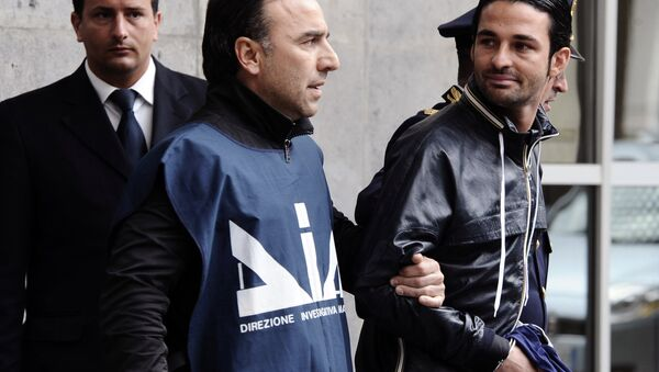 Paolo Schiavone, right, is escorted by Police officers after being arrested at Naples's port, Italy. (File) - Sputnik International