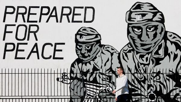 A man walks past a mural from the loyalist terror group the Ulster Volunteer Force in Belfast, Northern Ireland, Thursday, May, 3, 2007. - Sputnik International