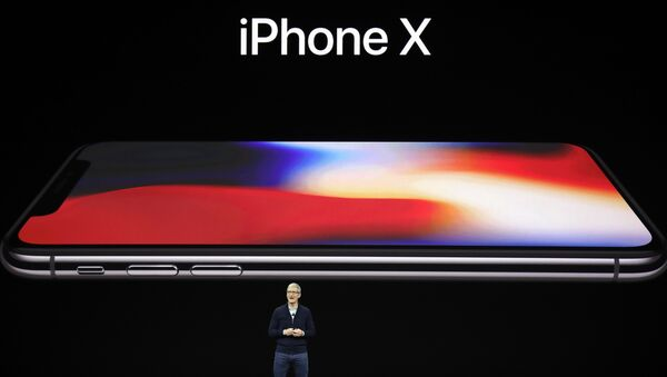 Apple CEO Tim Cook announces the new iPhone X at the Steve Jobs Theater on the new Apple campus, Tuesday, Sept. 12, 2017, in Cupertino, California. - Sputnik International