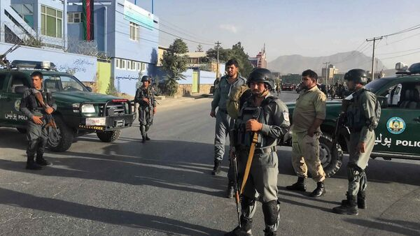 Afghan security police stand guard near the site of a deadly suicide attack outside a cricket stadium, in Kabul, Afghanistan - Sputnik International