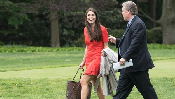 White House Director of Strategic Communications Hope Hicks (L) and Chief Strategist Steve Bannon (R) walk to board Marine One as US President Donald Trump departs the White House for Harrisburg, Pensylvannia, where he will hold a rally on the 100th day of his presidency on April 29, 2017 in Washington, DC - Sputnik International
