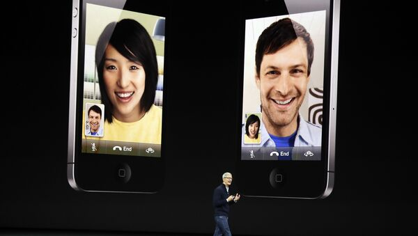Apple CEO Tim Cook discusses the new iPhone 8 at the Steve Jobs Theater on the new Apple campus, Tuesday, Sept. 12, 2017, in Cupertino, California. - Sputnik International