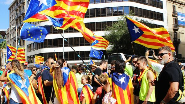 Participants in the rally in the streets of Barcelona support the referendum for independence and Catalonia's secession from Spain, which is timed to National Day of Catalonia - Sputnik International